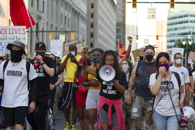 Detroit Will Breathe protesters took to the streets to demonstrate against police brutality over the summer. - STEVE NEAVLING