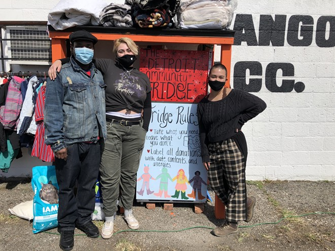 Ryan Yeargin (left) of the east side business Hats Galore & More partnered with Kazza Kitchell (center) and Alyssa Rogers (right) of Detroit Community Fridge, a mutual aid organization that's setting up free refrigerators and pantries in the city. - LEE DEVITO