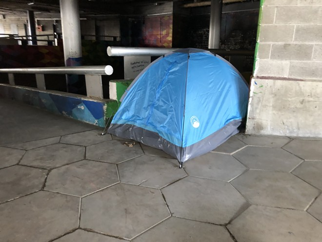 A tent in the underground part of Detroit's Hart Plaza. - LEE DEVITO
