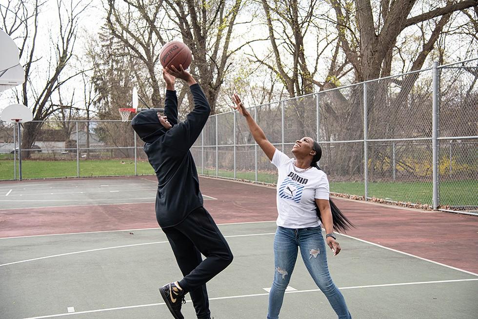 Dominica Sims-Sharda plays basketball with her son. - CYDNI ELLEDGE