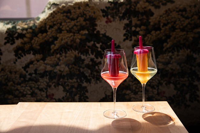 Pinky's Ice Pops — a glass of wine glass with a liquor-infused ice popsicle sticking out of it. - COURTESY PHOTO