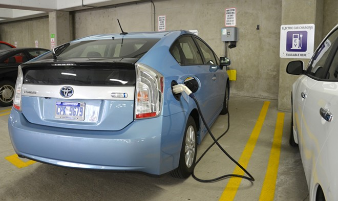 A car being charged at one of the 18 electric vehicle chargers in Ann Arbor on June 21, 2013. The federally funded chargers have delivered over 10,000 kilowatt hours. - SUSAN MONTGOMERY / SHUTTERSTOCK.COM