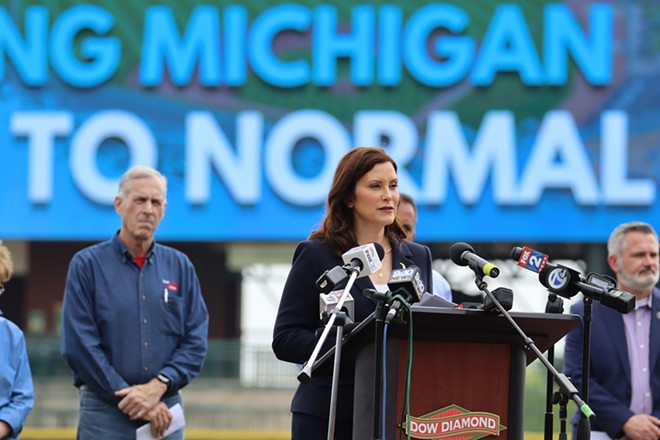 Gov. Gretchen Whitmer announces a new timetable to lift pandemic restrictions at Dow Diamond baseball stadium in Midland. - STATE OF MICHIGAN