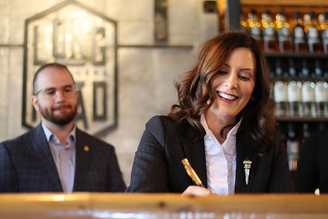 Gov. Whitmer signing bills, which will make it easier for distillers and retailers to distribute and sell mixed spirit drinks. - STATE OF MICHIGAN