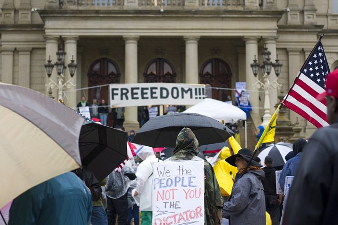 Protesters rallied against COVID-19 restrictions in Lansing in May 2020. - STEVE NEAVLING