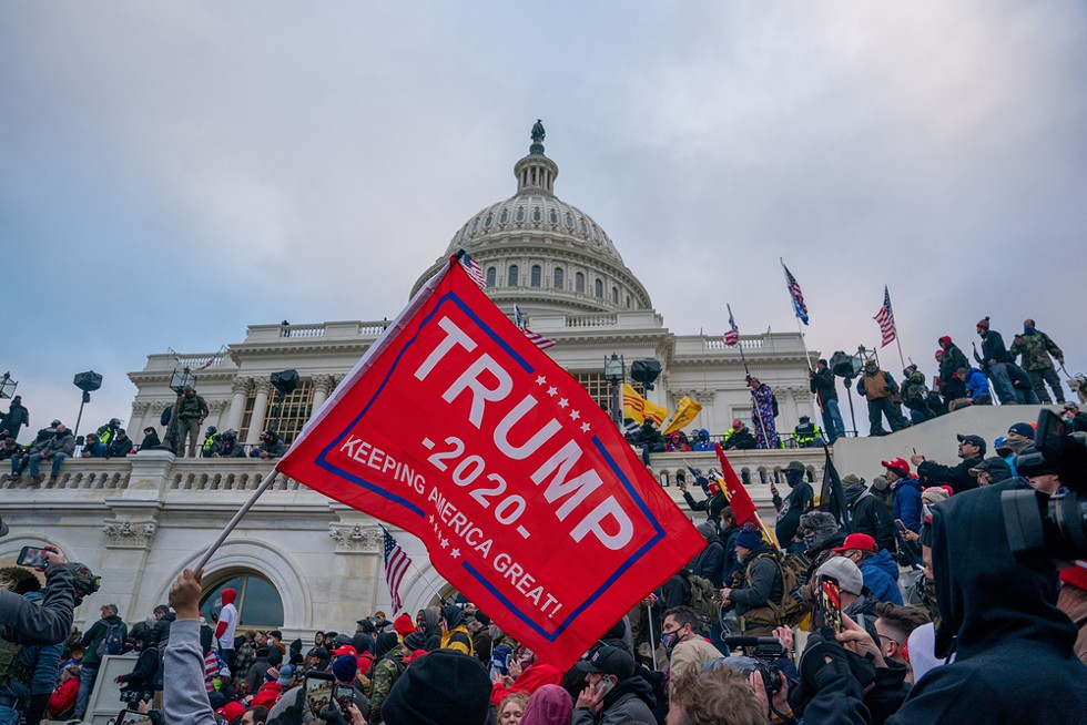 Trump supporters storm the United States Capitol building. - THOMAS HENGGE / SHUTTERSTOCK.COM