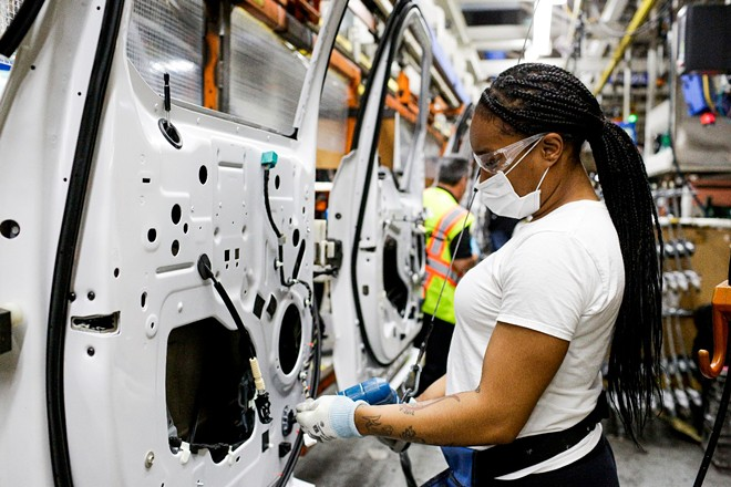 A woman working at Ford's Dearborn truck plant. - COURTESY OF FORD MOTOR CO.