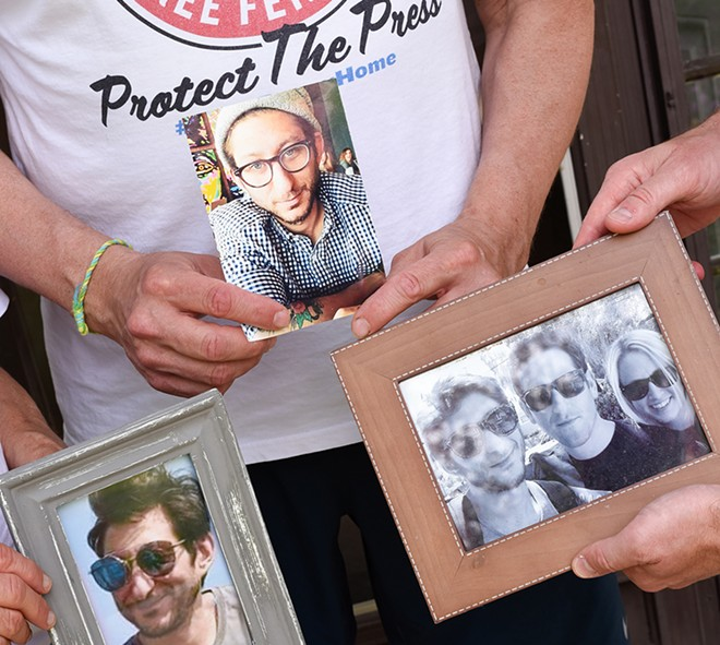 Journalist Danny Fenster's family holds photographs of him at their Huntington Woods home. - KELLEY O'NEILL