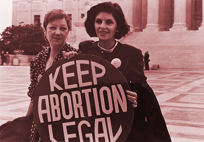 Norma McCorvey (Jane Roe) and her lawyer Gloria Allred on the steps of the Supreme Court, 1989. - LORIE SHAULL