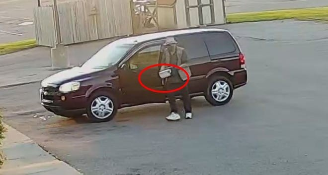 John Douglas Allen is shown carrying a box containing a bomb, FBI says. - U.S. ATTORNEY'S OFFICE