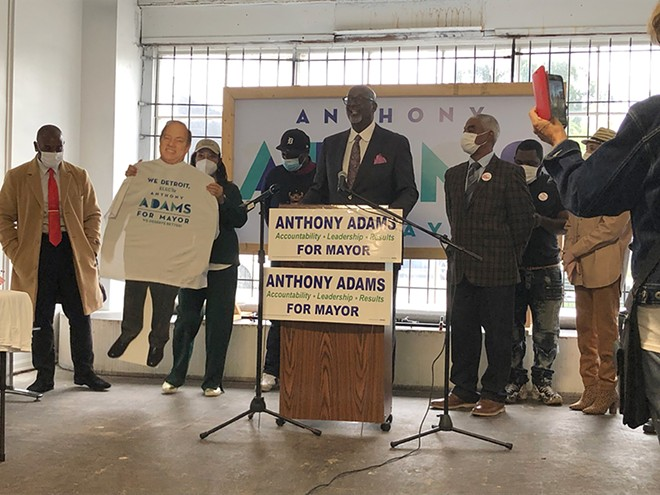 Detroit mayoral candidate Anthony Adams brings out a cardboard cutout of Mayor Mike Duggan, who has refused to debate him. - LEE DEVITO