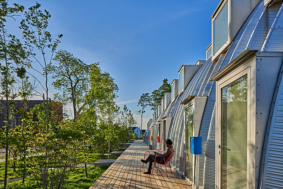 Detroit's Caterpillar project has a long porch, surrounded by newly planted trees. - JASON KEEN