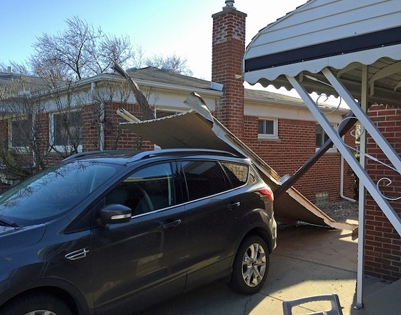 Reader Donald Calamia sent us this picture of his car wearing his neighbor's house's awning. - PHOTO COURTESY DONALD CALAMIA
