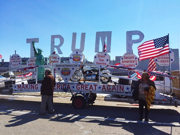"""In a show of support for the president, a Livonia man drove his """"Trump Unity Bridge"""" to the protest."""