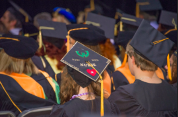 Wayne State University students gather for a commencement ceremony. Over the past 6 years, incoming freshman at the school have seen tuition increase by more than 25 percent. - WAYNE STATE UNIVERSITY, FLICKR