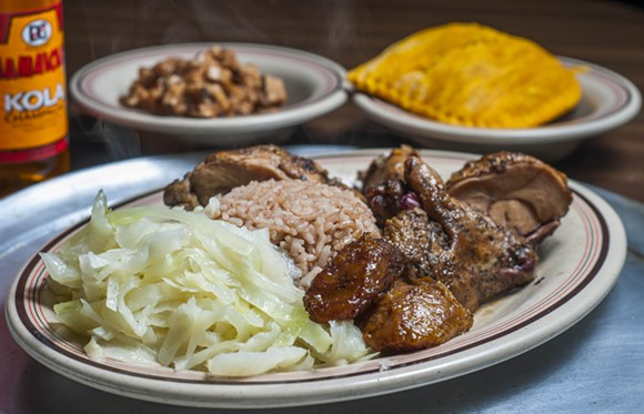 Jerk chicken at Rono's. - PHOTO BY TOM PERKINS
