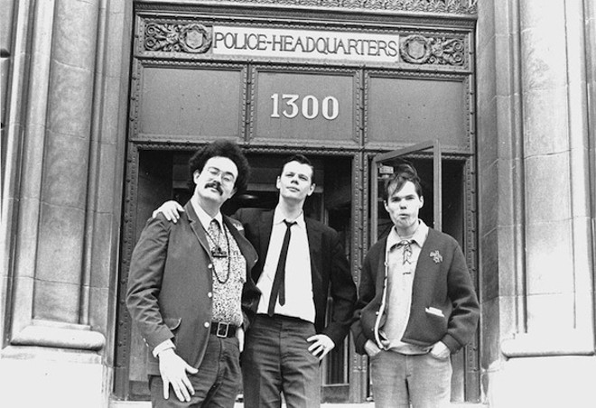 John Sinclair, Joe Mulkey and Billy Reid of the Detroit Artists Workshop after obtaining the license to hold the Love-In from the City of Detroit at Police Headquarters at 1300 Beaubien in the spring of 1967. - PHOTO BY LENI SINCLAIR