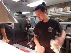 The Peterboro's chef de cuisine Brion Wong in the kitchen. - PHOTO BY SERENA MARIA DANIELS