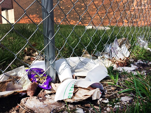 Trash along one of Henry Velleman's fences pictured earlier this spring. - PHOTO BY TOM PERKINS