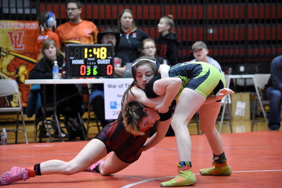 Katlyn Pizzo (left) sprawls during a match, fighting for control. - RACHEL TIMLIN