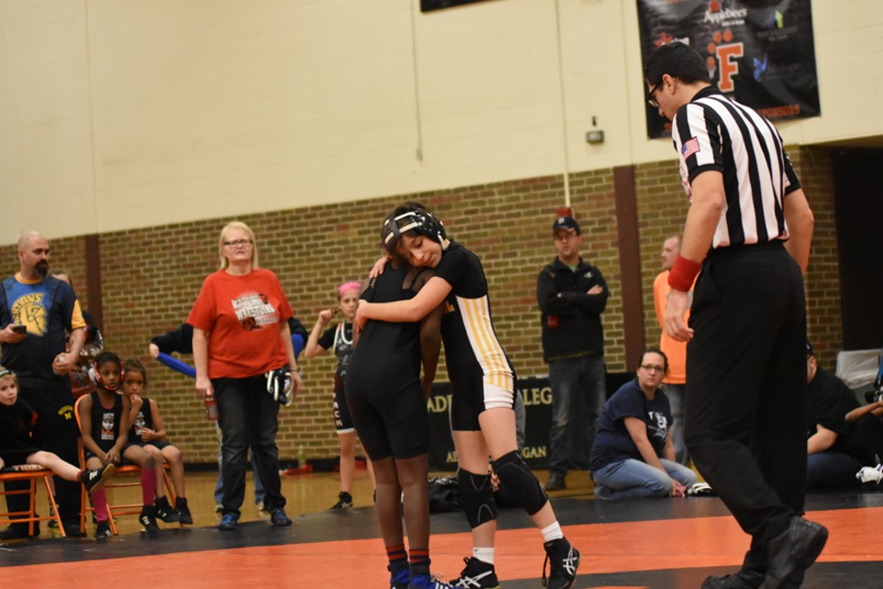 Female wrestlers don't hold back during competition, but matches might end with a handshake — or a hug. - RACHEL TIMLIN