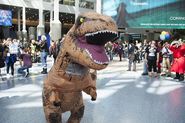 The T-Rex costume that caused a stir on MCCC's Clinton Township campus. Photo via Shutterstock.