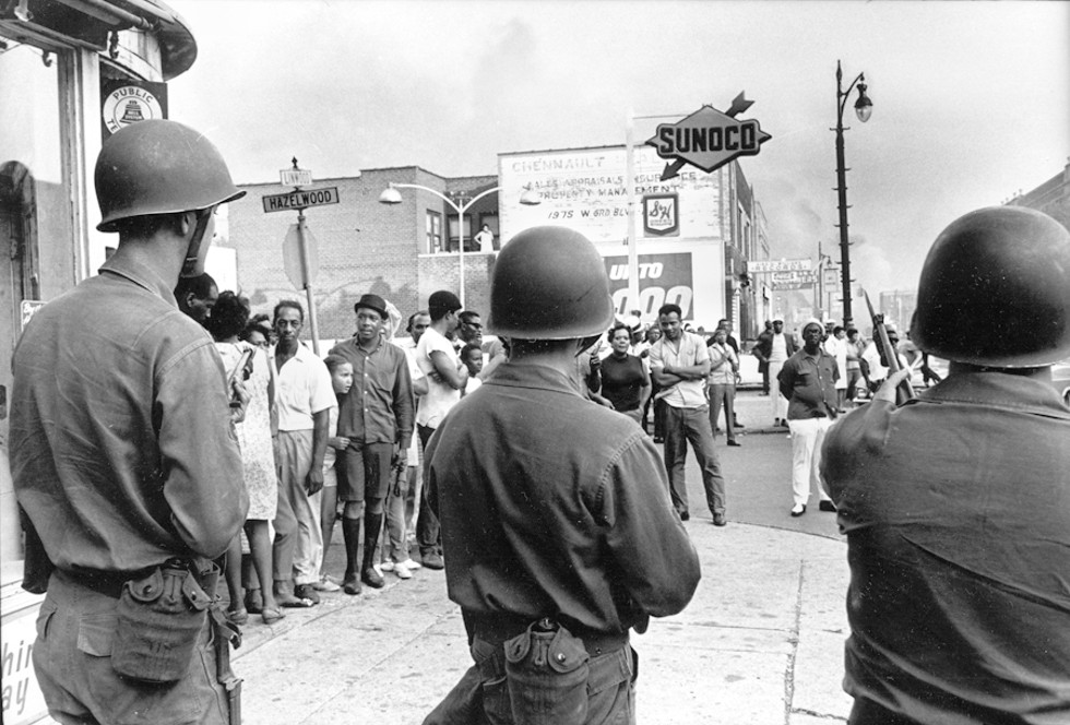 National Guardsmen patrol Detroit during the summer of 1967. - THE TONY  SPINA  COLLECTION,  WALTER  P.  REUTHER  LIBRARY,  ARCHIVES  OF  LABOR  AND  URBAN AFFAIRS, WAYNE STATE UNIVERSITY