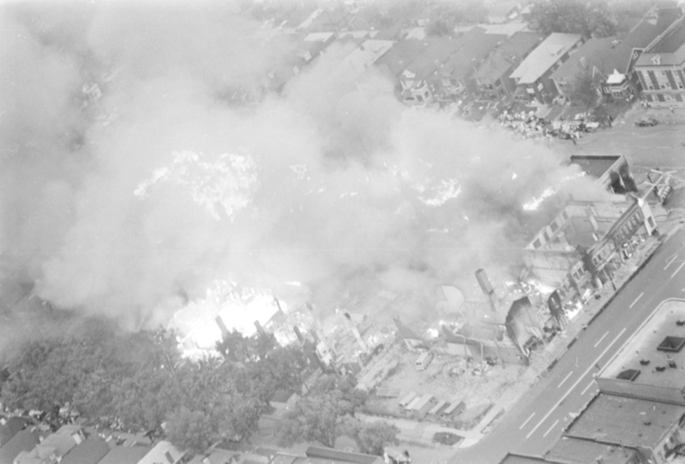An aerial view of Grand River as buildings are consumed by        fires. - WALTER P. REUTHER LIBRARY, ARCHIVES OF LABOR AND URBAN        AFFAIRS, WAYNE STATE UNIVERSITY