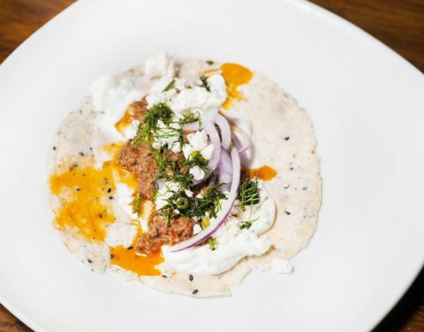 Greek taco with cinnamon lamb, feta, cucumber-garlic yogurt, dill, and Bulgarian feta. - TOM PERKINS