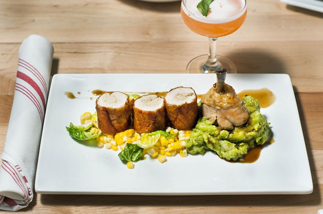 Fried chicken roulade, braised chicken leg, pesto mashed potatoes, corn, Brussel's sprouts, chicken jus - TOM PERKINS
