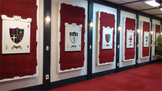 The heraldic displays conceal the club's many dartboards. - PHOTO BY MICHAEL JACKMAN