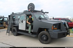 At armored truck in Cleveland. - RAYMOND WAMBSGANS, FLICKR CREATIVE COMMONS