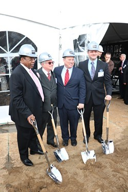 Detroit Mayor Mike Duggan poses with developers of the luxury DuCharme Place in Lafayette Park in 2015. - COURTESY PHOTO