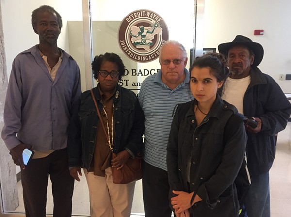 Moratorium Now! organizer Jerome Goldberg (center) and several other activists made their way through the Coleman A. Young Municipal Center Tuesday, urging Detroit city officials to save nearly 2,000 occupied properties from being sold at auction. - VIOLET IKONOMOVA