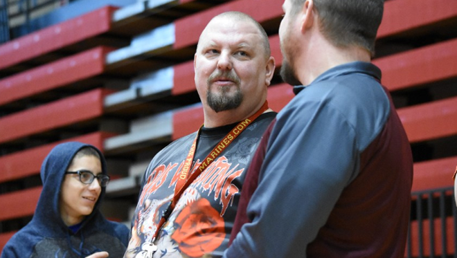 Female wrestling coach, promoter, and advocate Brent Harvey, center, has died. - PHOTO BY RACHEL TIMLIN