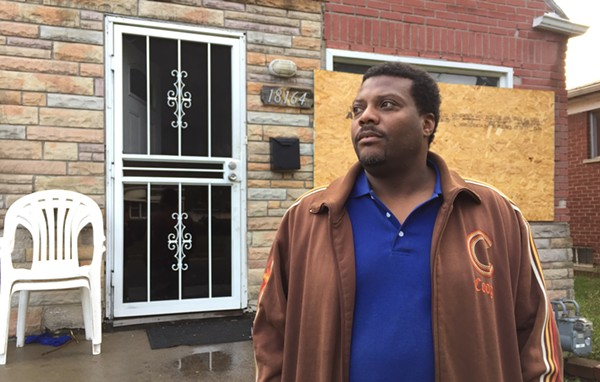 Kevin Dickerson in front of his Detroit home the day after it sold in the Wayne County tax foreclosure auction. - VIOLET IKONOMOVA
