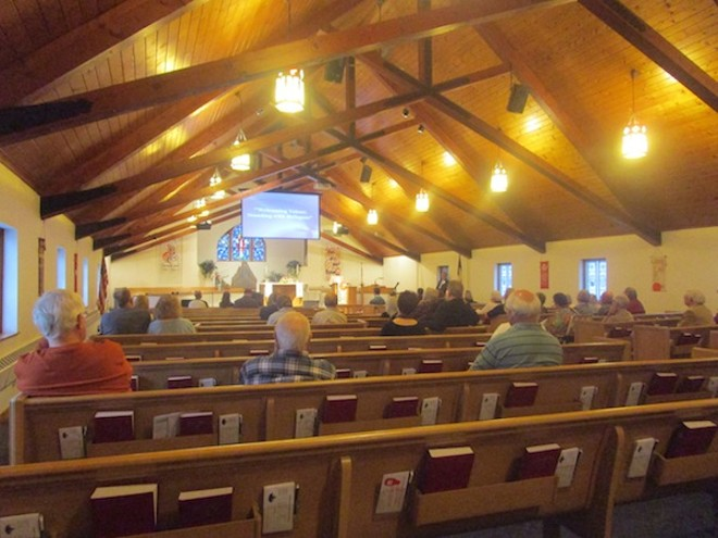 An audience eager to hear sympathetic perspectives on refugees at Waterford's Christ Lutheran Church. - PHOTO BY MICHAEL JACKMAN