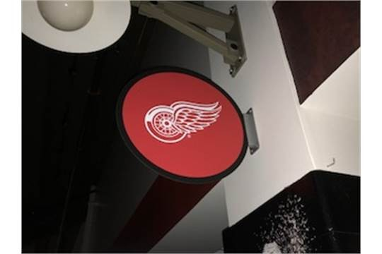 Puck sign with Red Wings logo.