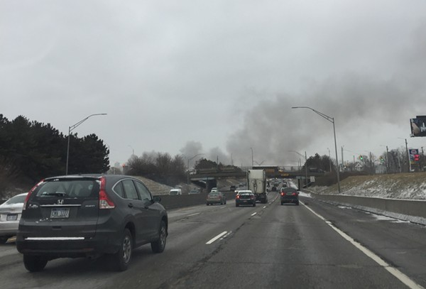 Commuters could see smoke pouring over I-94 as the fire burned through the rush hours. - VIOLET IKONOMOVA