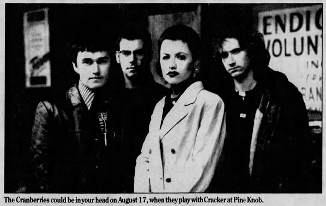 The Cranberries with O'Riordan (second from right) in a promotional poster for their August 17, 1996 concert at Pine Knob Music Theater. - PHOTO COURTESY OF THE CONCERT DATABASE.