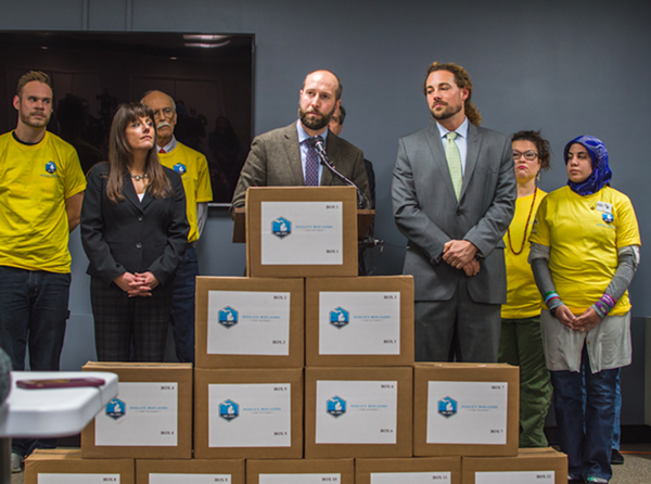 The Coalition to Regulate Marijuana Like Alcohol submits 365,000 petition signatures in support of marijuana legalization to the state Board of Canvassers on Nov 20, 2017. - COURTESY PHOTO