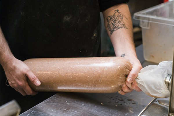 Packing bologna at Stache. - TOM PERKINS