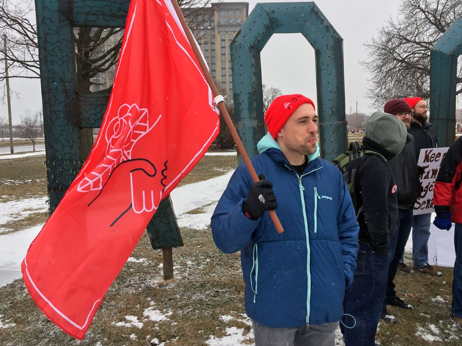 A DSA member stands in solidarity with immigration activists at a January demonstration in Detroit to urge Congress to pass the Dream Act. - VIOLET IKONOMOVA