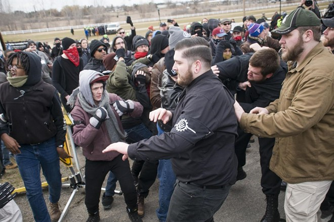 A neo-Nazi group and anti-fascist protesters clash. - TOM PERKINS
