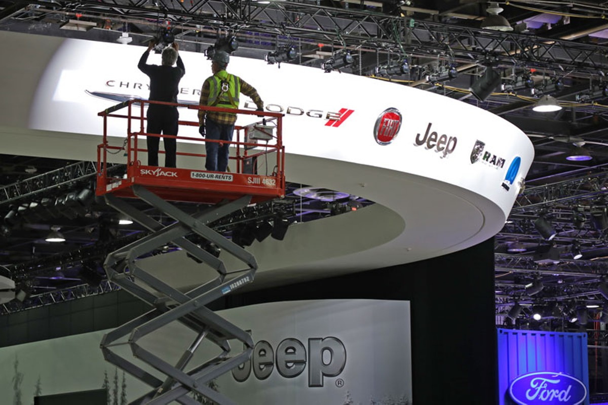 Workers setting up NAIAS at Cobo Center.