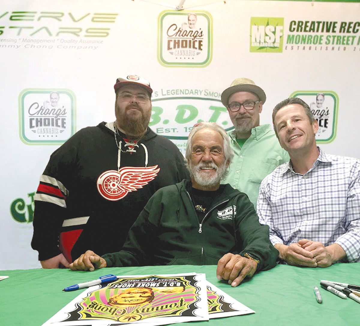 n Duane Slicker, left, Charlie Strackbein, and Curtis Goure of B.D.T. Smoke Shops with comedian Tommy Chong .
