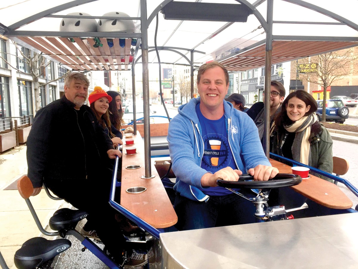 The Metro Times newsroom pedals the Detroit Cycle Pub downtown with the business' cofounder Nick Blaszczyk.