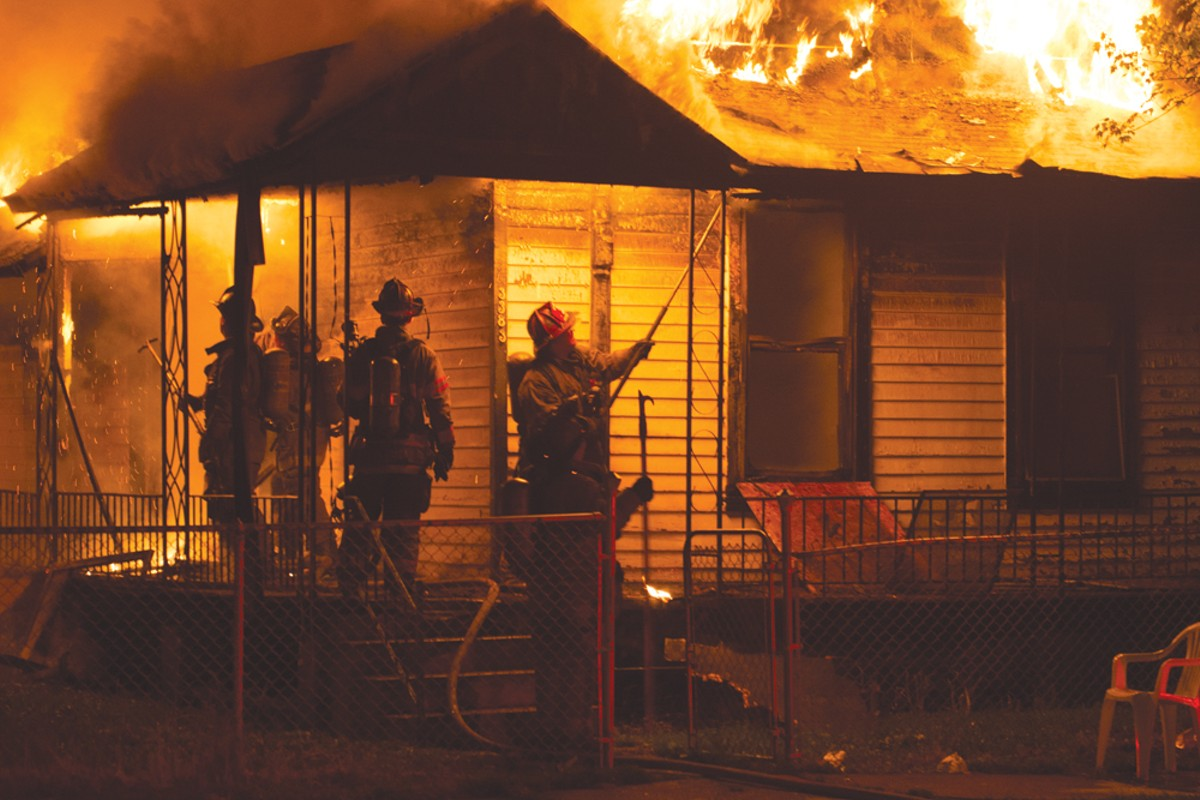 Detroit firefighters work to extinguish a blaze at 3383 15th St. on July 2, 2015.
