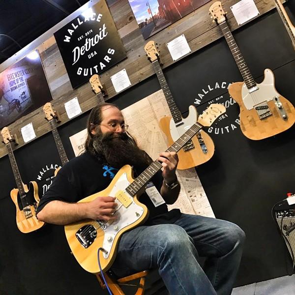 Laith Al-Saadi playing a Wallace Detroit guitar in 2017. - WALLACE DETROIT GUITARS FACEBOOK.