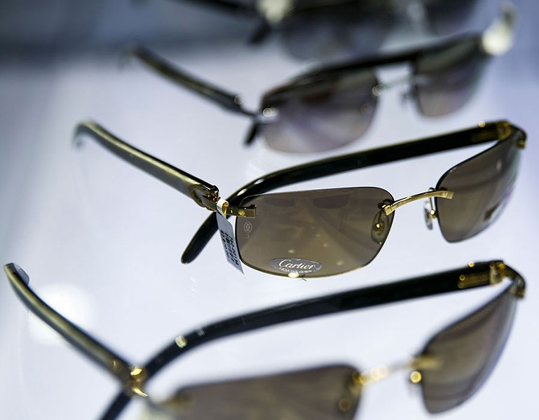 1bf2782565e Cartier sunglasses on display at Optica at Somerset Collection. - SEAN  PROCTOR